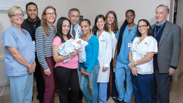 Lillian Sjolund-English, RN; Cristian Acevedo; Dr. Kirsten Cleary; Rosa Taveras with her son, Elijah; Dr. Steven Stylianos; Carmen Taveras; Dr. Amy Turitz; Lindsay Spring; Natahalie David; Heather Duignan, RN; and Dr. Jack Maidman.